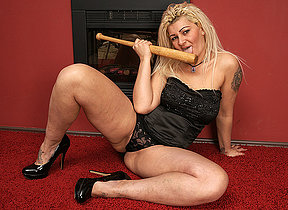 Naughty housewife going to bed her baseball bat