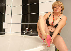 Hairy chubby old woman playing in the bath