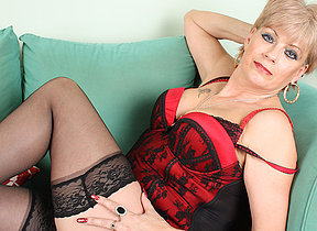 British MILF pleases herself on couch