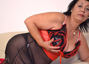 This horny mom loves to get juicy on her couch