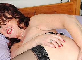 Naughty red mature slut playing with herself