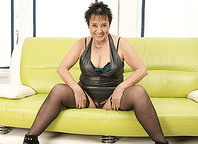Horny mature whore playing on the sofa