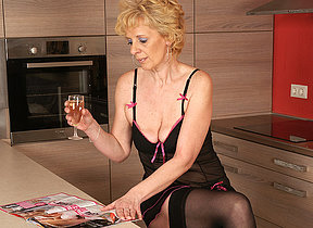 This blonde mature hussy loves to masturbate in her kitchen