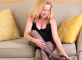 Horny American missis playing on the sofa
