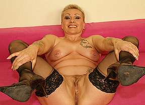 This horny mature whore really loves her toy