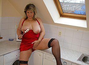 Big missus playing in her kitchen