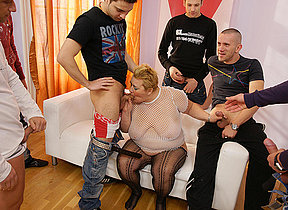 This kinky MILF gets the cum of seven men in her face