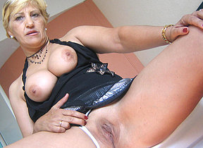 Horny mature whore Teresa loves playing with her toys