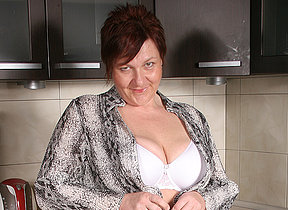 Big breasted mature hussy playing in her kitchen