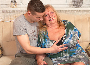 Big breasted mom playing with her toy boy