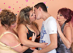 Three mature housewives sharing one hard cock