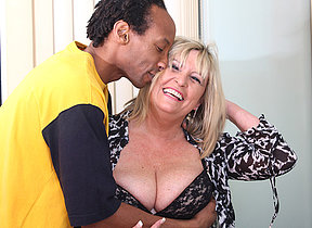 British chubby mature lady munching on a black cock