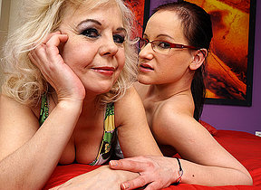 Horny old and young lesbian couple playing in bed