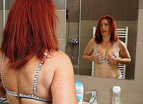 Horny redhead missis getting herself off