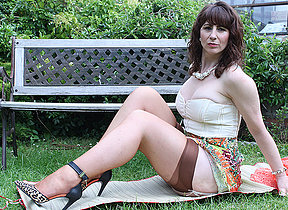 Horny British housewife shows her hot body and masturbates in the garden