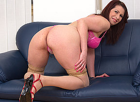 Horny mature whore playing on the couch