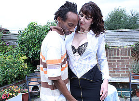 Horny British housewife munching on a black cock