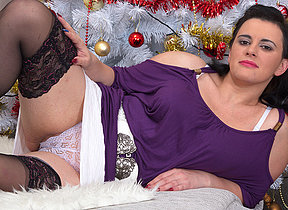 Naughty housewife masturbating under the christmas tree
