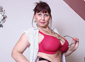 Big titted British mature lady getting very dirty