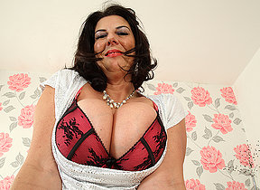 Big breasted British mature hussy getting very naughty