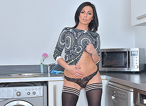 Hot British mama getting naughty in the kitchen