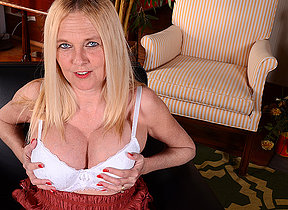Naughty big titted American missus playing alone