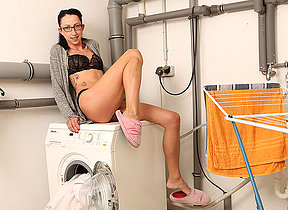 German housewife doing her laundry naked