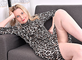 Horny British missis getting wet and wild on her couch