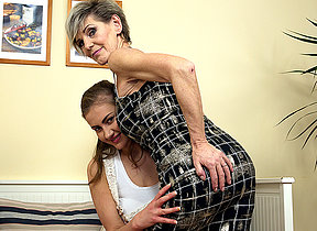 Sexy old and young lesbian couple share a dildo