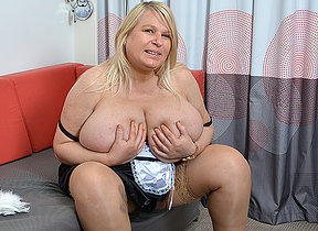 Huge titted British lady getting juicy on her couch