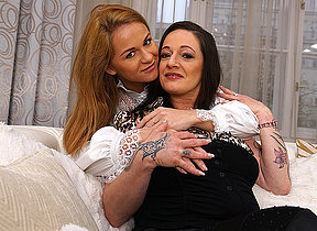 Naughty old and young lesbians make out on the couch