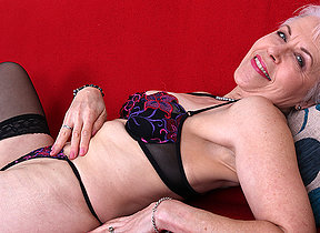 Naughty British mature lady getting wet on her sofa