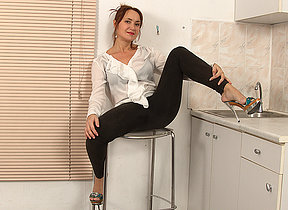 Hairy missus getting wet in her kitchen