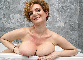 Steamy MILF with big tits playing in the bathroom