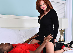 Sexy MILF fucking and sucking a big black dick