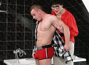 Naughty mature lady catching a toyboy in the bathroom