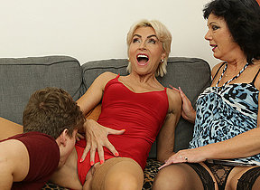 Two horny Milfs share their toyboys cock in sexy threesome