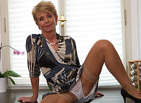 Elegant grandma shows off sexy body and plays with her toy