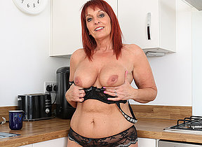 British Milf Beau Diamonds strips off her clothes and plays with her vagina