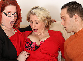 Two busty British housewives share their toyboys cock in sexy threesome